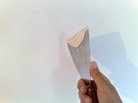 Repasar agujeros con espatula
